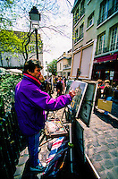French artist painting in Place du Tertre on Montmartre, Paris, France