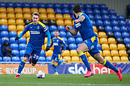 AFC Wimbledon striker Joe Pigott (39) dribbling and about to pass to AFC Wimbledon striker Ollie Palmer (9) during the EFL Sky Bet League 1 match between AFC Wimbledon and Lincoln City at Plough Lane, London, United Kingdom on 2 January 2021.