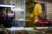 .Mari Palacios makes tortillas inside the new Burritos Crisostomo in El Paso Texas on Sunday morning, Oct. 11, 2009..