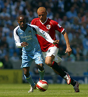 Photo: Paul Thomas.<br /> Manchester City v Manchester United. The Barclays Premiership. 05/05/2007.<br /> <br /> Wes Brown (R) of Utd tries to tackle DaMarcus Beasley.