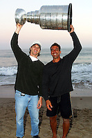 24 August 2002: Detroit Red Wings professional hockey players and friends Chris Chelios and Luc Robitaille together hold the NHL Stanley Cup over their head at sunset on the beach at the Pacific Ocean in front of Chris's summer Malibu home in Los Angeles. .