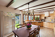 Domestic kitchen of a classical house, dining table