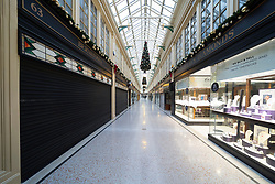 Glasgow, Scotland, UK. 21 November 2020. Views of Saturday afternoon in Glasgow city centre on first day of level 4 lockdown. Non essential shops and businesses have closed. And streets are very quiet. Pictured;  Argyll Arcade is empty and shops are closed .Iain Masterton/Alamy Live News