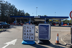 Licensed to London News Pictures. 24/09/2021. London, UK. Tesco petrol station closes due to lack of fuel near the A3 in New Malden south-west London with all of its pumps out of action this afternoon as oil giants struggle to maintain deliveries due to the lack of HGV drivers as the fuel shortage crisis continues. Photo credit: Alex Lentati/LNP
