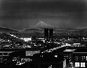 Y-540105-02. Night view of Mt. Hood & Portland from Oregonian composing room. Color transparency January 5, 1954
