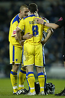 Photo: Aidan Ellis.<br /> Sheffield Wednesday v Cardiff City. Coca Cola Championship. 09/11/2005.<br /> Cardiff's Darren Purse congratlutes Jason Koumas on his goal as he recives treatment after scoring