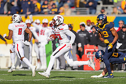 Nov 9, 2019; Morgantown, WV, USA; Texas Tech Red Raiders defensive back Damarcus Fields (23) runs after intercepting a pass during the third quarter against the West Virginia Mountaineers at Mountaineer Field at Milan Puskar Stadium. Mandatory Credit: Ben Queen-USA TODAY Sports