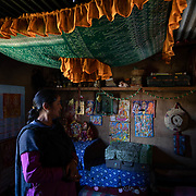 Mamta Pandey stands in her home's Hindu pooja room, 20km from Ranikhet, India on Dec. 6, 2018. Whe women's knitting circle has broken down religious boundaries between members.