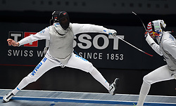 WUXI, July 27, 2018  Andrea Cassara (L) of Italy fights with Miles Chamley-Watson during the men's foil team final between Italy and the United States at the Fencing World Championships in Wuxi, east China's Jiangsu Province, July 27, 2018. Italy beat US 45-34 and claimed the title of the event. (Credit Image: © Han Yuqing/Xinhua via ZUMA Wire)
