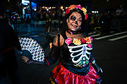 New York, NY - 31 October 2019. the annual Greenwich Village Halloween Parade along Manhattan's 6th Avenue. A woman costumed as the Mexican calavera catrina.