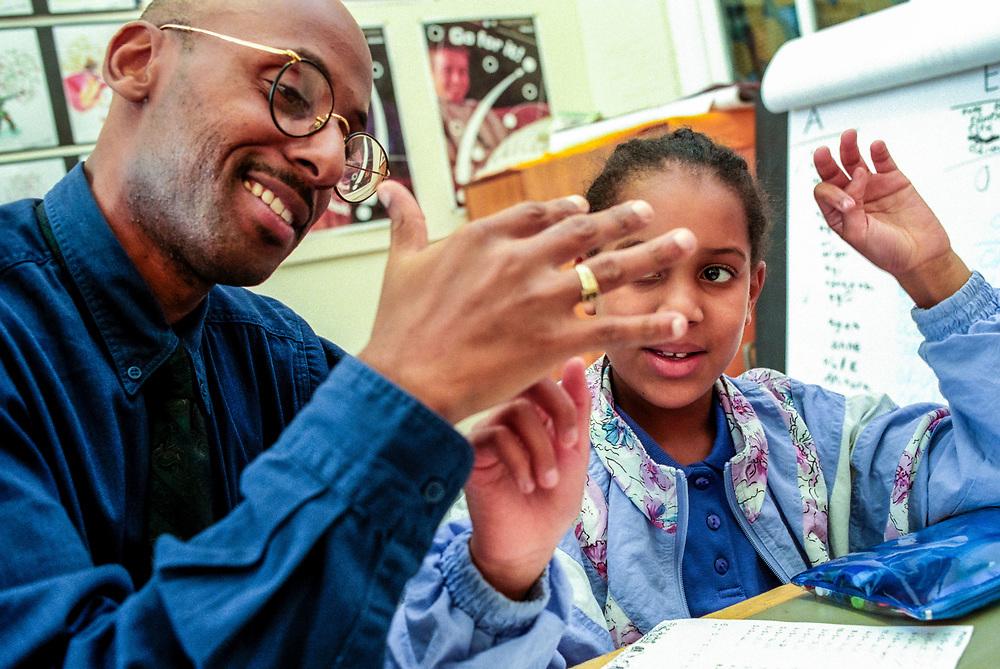 Teacher doing maths with children,
