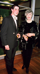The EARL OF DENBIGH & DESMOND and his mother the DOWAGER<br />  COUNTESS OF DENBIGH & DESMOND, at a reception in London on<br />  17th April 2000.OCX 34