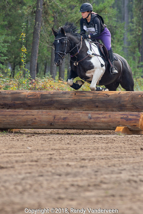 Photo Randy Vanderveen<br /> County of Grande Prairie, Alberta<br /> 2018-09-02<br /> Morgan Hellekson aboard Final Coat clears an obstacle during the cross-country event at the South Peace Horse Club's eventing at Evergreen Park, Sunday. The two-day annual equestrian competition had riders and mounts competing in dressage, stadium (show jumping) and cross country.