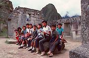 PERU, PREHISPANIC, INCA Machu Picchu; school children at site