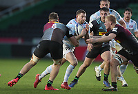 Finn Russell of Racing 92 is tackled by Hugh Tizard and Alex Dombrandt (8) of Harlequins