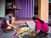 25 AUGUST 2018 - GEORGE TOWN, PENANG, MALAYSIA: People burn ghost money on the street on Ghost Day, the full moon day (or night) that falls in the middle of Hungry Ghost month. The Ghost Festival, also known as the Hungry Ghost Festival is a traditional Taoist and Buddhist festival held in Chinese communities throughout Asia. Ghost Day, is on the 15th night of the seventh month (25 August in 2018). During Ghost Festival, the deceased are believed to visit the living. In many Chinese communities, there are Chinese operas and puppet shows and elaborate banquets are staged to appease the ghosts.      PHOTO BY JACK KURTZ