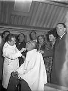Mr Noel Purcell having his beard removed for Pantomime - Special for Radio Review.23/12/1955<br />