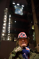 © Licensed to London News Pictures.31/12/2020, London, UK. Brexit supporter outside the Big Ben in central London to celebrate, the day Britain leaves the European Union. The countdown begin in Brussels at midnight UTC thus, 11pm GMT in London. Photo credit: Marcin Nowak/LNP