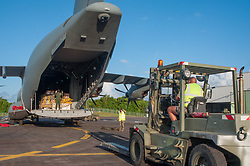 An Airbus A400M military aircraft coming from Orleans, France, landed in Fort-de France, the capital of France's Caribbean overseas department of Martinique on September 9, 2017. Onboard, a Puma helicopter and humanitarian freight to bolster relief support in French Overseas Territories after hurricane Irma struck. On 6 and 7 September 2017, the island was hit by Category 5 Hurricane Irma, which caused widespread and significant damage to buildings and infrastructure. A total of 11 deaths had been reported as of 8 September. France's Minister of the Interior said on 8 September that most of the schools were destroyed on the French half of the island. In addition to damage caused by high winds, there were reports of serious flood damage to businesses in the village of Marigot. Looting was also a serious problem. France sent aid as well as additional police and emergency personnel to the island. 95% of the structures were damaged or destroyed. Photo by ADC Choury/Armée de terre/ECPAD/ABACAPRESS.COM