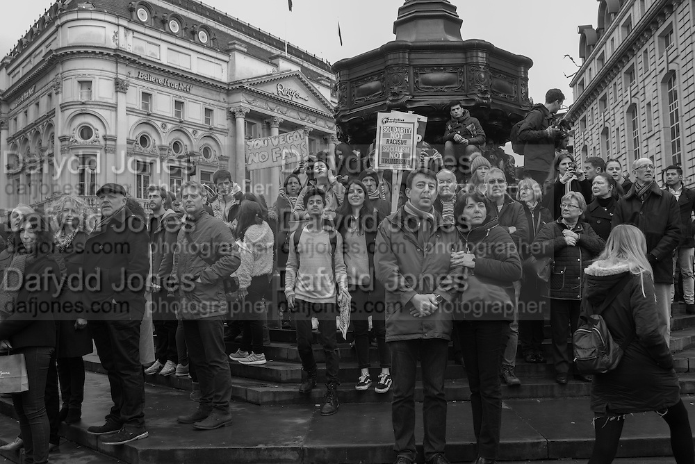 Members of the public watching the London protest against the US Muslim travel Ban. Outside the american Embassy and March to Downing St. 4 February 2017