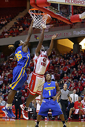 06 December 2008: Dinma Odiakosa puts up an offering but it is rejected by a foul collecting Kenneth Faried during a game where the  Illinois State University Redbirds extended their record to 9-0 with a 76-70 win over the Eagles of Morehead State on Doug Collins Court inside Redbird Arena on the campus of Illinois State University in Normal Illinois