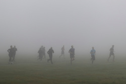 © Licensed to London News Pictures. 09/10/2021. London, UK. Members of the public take part in an exercise class during heavy fog in Greenwich Park in South East London. A yellow weather warning for fog is in place in parts of London and South East England.  Photo credit: George Cracknell Wright/LNP