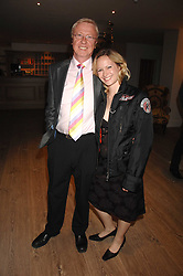 TV producer MIKE HOLLINGSWORTH former husband of Anne Diamond and MISS KIMBERLEY STEWART-MOLE at a party to celebrate the launch of a new fashion label 'Oli' at the Haymarket Hotel, 1 Suffolk Place, London on 4th July 2007.<br />
