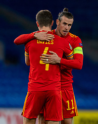 CARDIFF, WALES - Sunday, November 15, 2020: Wales' captain Gareth Bale (R) celebrates with team-mate Ben Davies at the final whistle during the UEFA Nations League Group Stage League B Group 4 match between Wales and Republic of Ireland at the Cardiff City Stadium. Wales won 1-0. (Pic by David Rawcliffe/Propaganda)