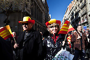 Thousands of people march in Barcelona against the Independence's Call of the Catalan Government. The strike has been organized by the PP, Ciutadans and UPD Political Partys. The strikers don't want the indepenpendence of Catalonia. They feel spanish and catalan. Location: Via Laietana Street.