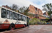 A handy free shuttle bus drives visitors to scenic stops through Zion National Park and Springdale, in Utah, USA. Travel on the scenic six-mile Zion Canyon Scenic drive is now thankfully closed to private cars and limited to buses, thereby reducing traffic and improving visitor experience. Visiting the canyon is now much more relaxing compared to when cars fought for space on the narrow Scenic Drive. The North Fork of the Virgin River carved spectacular Zion Canyon through reddish and tan-colored Navajo Sandstone up to half a mile (800 m) deep and 15 miles (24 km) long. Uplift associated with the creation of the Colorado Plateaus lifted the region 10,000 feet (3000 m) starting 13 million years ago. Zion and Kolob canyon geology includes 9 formations covering 150 million years of mostly Mesozoic-aged sedimentation, from warm, shallow seas, streams, lakes, vast deserts, and dry near-shore environments. Mormons discovered the canyon in 1858 and settled in the early 1860s. U.S. President Taft declared it Mukuntuweap National Monument in 1909. In 1918, the name changed to Zion (an ancient Hebrew name for Jerusalem), which became a National Park in 1919. The Kolob section (a 1937 National Monument) was added to Zion National Park in 1956. Unusually diverse plants and animals congregate here where the Colorado Plateau, Great Basin, and Mojave Desert meet.