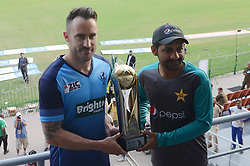 September 12, 2017 - Lahore, Punjab, Pakistan - Pakistani cricket captain Sarfraz Ahmad (R) and International World XI captain Faf du Plessis hold the Independence Cup trophy during a press conference at the Gaddafi Cricket in Lahore on September 11, 2017. A World XI squad comprising 13 players from seven top cricket-playing nations landed in Lahore early on September 11 amid massive security, with Pakistan hoping the tour will end years of international isolation  (Credit Image: © Rana Sajid Hussain/Pacific Press via ZUMA Wire)
