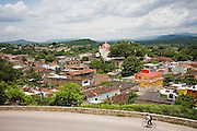 A man bikes past the city of Chiapa de Corzo, Chiapas state, Mexico on June 26, 2008. Large numbers of tourists travel here to visit the nearby Canon del Sumidero.