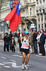 18.04.2010, Wien, AUT, Vienna City Marathon 2010, im Bild ein Läufer mit Fahne,  EXPA Pictures © 2010, PhotoCredit: EXPA/ T. Haumer / SPORTIDA PHOTO AGENCY