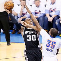 06 May 2016: San Antonio Spurs forward David West (30) goes for the baby hook over Oklahoma City Thunder forward Kevin Durant (35) during the San Antonio Spurs 100-96 victory over the Oklahoma City Thunder, during Game Three of the Western Conference Semifinals of the NBA Playoffs at the Chesapeake Energy Arena, Oklahoma City, Oklahoma, USA.