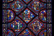 Medieval stained glass Window of the Gothic Cathedral of Chartres, France - dedicated to Noah and The Flood.Central Diamond panel - God instructs Noah to build an ark - The two panels below and the panels left and right show God instructing Noah to build an ark . Panel top left - Noah's sons; Shem, Ham and Japheth, panel top right - Noah's wife and daughters in law  .A UNESCO World Heritage Site.. .<br /> <br /> Visit our MEDIEVAL ART PHOTO COLLECTIONS for more   photos  to download or buy as prints https://funkystock.photoshelter.com/gallery-collection/Medieval-Middle-Ages-Art-Artefacts-Antiquities-Pictures-Images-of/C0000YpKXiAHnG2k