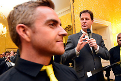 © Licensed to London News Pictures. 11/09/2013. London, UK Nick Clegg (right) makes a speech surrounded by members of the London Gay Men Chorus. The Deputy Prime Minister, Nick Clegg, hosts a reception at Admiralty House in Whitehall this evening, 11 September 2013, to celebrate the government's progress in equal marriage. From next year gay people will be able to get married. A number of high profile guests including openly supportive celebrities, campaigners, religious figures and charities were in attendance.<br /> The London Gay Men Chorus Ensemble performed at the event. . Photo credit : Stephen Simpson/LNP