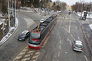 A new style number 20 tram drives over a cobbled road, on 18th March, 2018, in Prague, the Czech Republic.