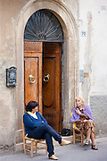 Local women sitting out in Piazza Cavovr in Montalcino, Val D'Orcia,Tuscany, Italy