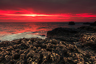 Blood red sunrise by the sea
