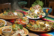 KEVIN BARTRAM/The Daily News.Sizzling fajitas are at the center of a Cinco de Mayo spread at the new Salsa's restaurant in League City on Thursday, April 21, 2005.