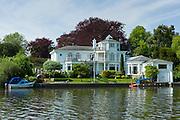 Luxury riverside houses on the banks of the River Thames in Berkshire,  UK