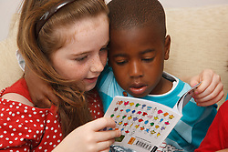 White girl reading to black boy