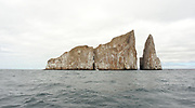 León Dormido or Kicker Rock is the eroded remains of a volcanic eruption that became explosive when lava and seawater mixed. This pyroclastic or palagonite tuff cone has been eroded over tens of thousands of years. It has become a world famous dive and snorkelling site. San Cristobal, Galapagos, Ecuador.