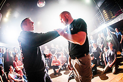 Tommy Blom shows the students the next knife defence exercise. IKMS 'In The Club' seminar with KMG Global Team Instructor and Expert Level 5, Tommy Blom, at the Buff Club in Glasgow's City Centre. Bringing Krav Maga training out with the confines of the gym into a real nightclub/bar.<br /> © Michael Schofield.