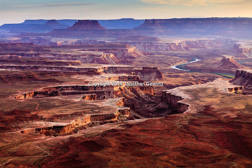 Distant view of the Green River as it passes through Canyonlands National Park, Utah. WATERMARKS WILL NOT APPEAR ON PRINTS OR LICENSED IMAGES.<br /> <br /> Licensing: https://tandemstock.com/assets/40899655