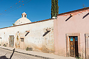 Emply street in the ghost town of Mineral de Pozos, Guanajuato, Mexico. The town, once a major silver mining center was abandoned and left to ruin but has slowly comeback to life as a bohemian arts community.