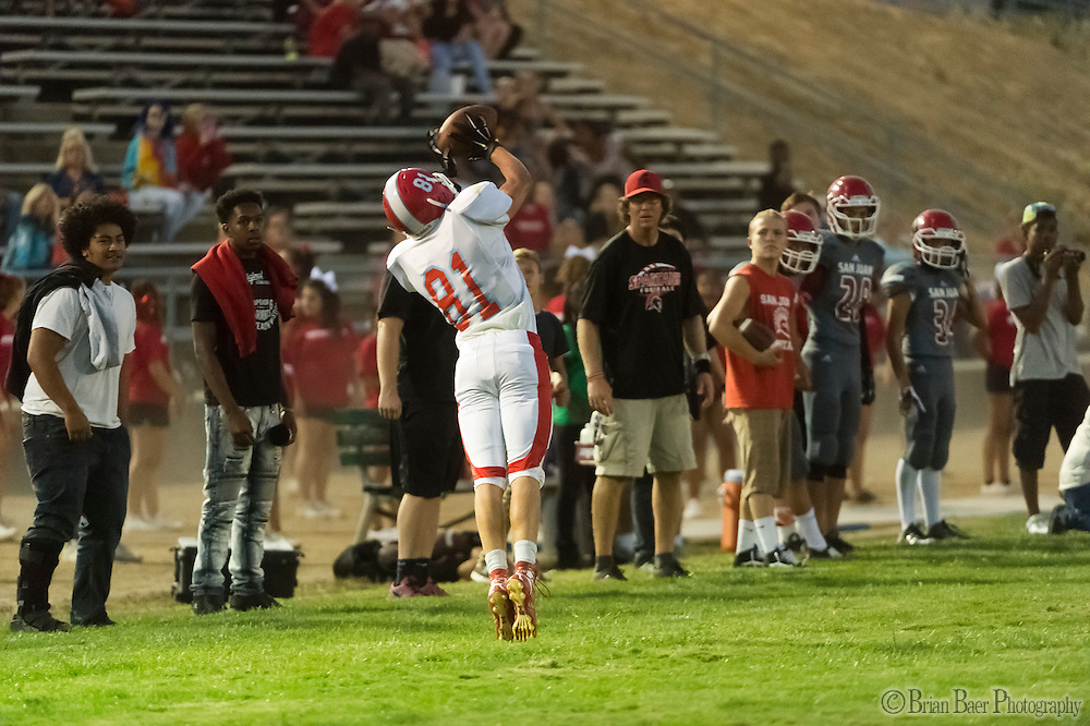 Mira Loma Matadors Dorin Matveev (81), catches the ball on the side line in front of the San Juan Spartans bench during the first quarter as the San Juan Spartans host the Mira Loma Matadors, Friday Sep 16, 2016.<br /> photo by Brian Baer