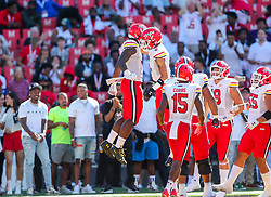 Sep 4, 2021; College Park, Maryland, USA; Maryland Terrapins tight end Chigoziem Okonkwo (9) scores a touchdown and celebrates with teammates during the first quarter against the West Virginia Mountaineers at Capital One Field at Maryland Stadium. Mandatory Credit: Ben Queen-USA TODAY Sports