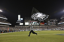 A Philadelphia Eagles flag is carried across the field after an Eagles field goal during the NFL game between the Carolina Panthers and the Philadelphia Eagles at Lincoln Financial Field in Philadelphia, Pennsylvania on Monday November 10th 2014. The Eagles won 45-21. (Brian Garfinkel/Philadelphia Eagles)
