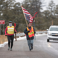 Martina Maryboy, left, and Micheal Manuel participate in the Diné Missing and Murdered Indigenous People Sunrise Prayer Run Tuesday, Jan. 21 just west of St. Michaels on Arizona State Route 264. The 250-mile prayer run began in Flagstaff on Friday Jan. 17 and ended in Window Rock Tuesday Jan. 21 at the Navajo Nation Tribal Park.